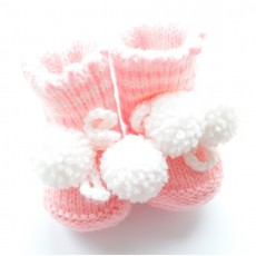 Knitted booties for a newborn girl