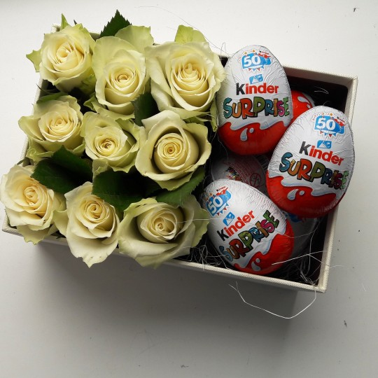 White Roses with Kinder Eggs in flower Box. Send flowers Riga