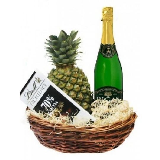Pineapple, champagne and chocolate in basket